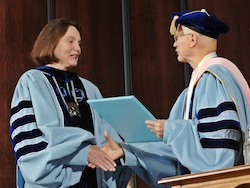 Anne Ponder, chancellor of the University of North Carolina at Asheville receives her distinguished alumna award from University of North Carolina at Chapel Hill Chancellor James Moeser, right during University Day at UNC-Chapel Hill Friday.