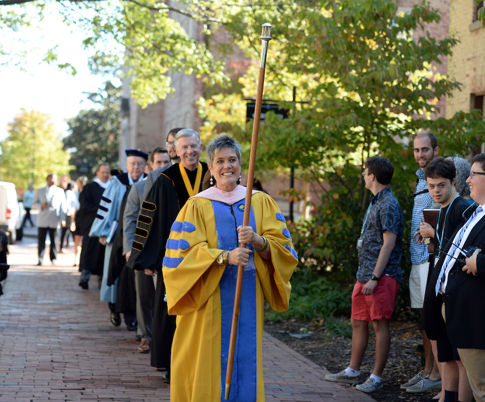 Faculty Marshal Terry Rhodes leads the platform party from South Building to Memorial Hall for the 2015 University Day ceremony at the University of North Carolina at Chapel Hill.